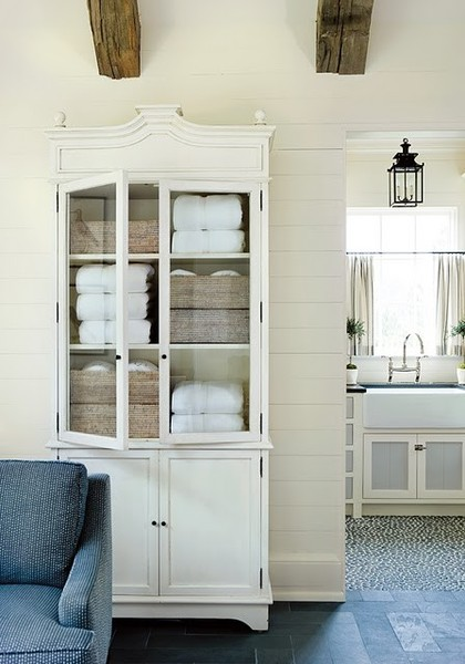 space in your bathroom for linen storage love the punch of colour